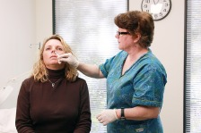 "This image depicts a qualified nurse in a clinical setting, who was in the process of administering a dosage of FluMist® live attenuated intranasal vaccine LAIV) into the left nostril, and into this patient's nasal cavity. Note that the nurse's hands were gloved, thereby, avoiding the possibility of cross-contamination.  What kind of flu vaccines are there?There are two types of flu vaccines: - 1. The ""flu shot"" — is an inactivated vaccine (containing killed virus) that is given with a needle, usually in the arm. The flu shot is approved for use in people older than 6 months, including healthy people and people with chronic medical conditions.There are three different flu shots available: - a regular flu shot approved for people ages 6 months and older - a high-dose flu shot approved for people 65 and older, and - an intradermal flu shot approved for people 18 to 64 years of age. - 2. The nasal-spray flu vaccine — is a vaccine made with live, weakened flu viruses that is given as a nasal spray (sometimes called LAIV for ""Live Attenuated Influenza Vaccine""). The viruses in the nasal spray vaccine do not cause the flu. LAIV is approved for use in healthy* people 2 through 49 years of age who are not pregnant."