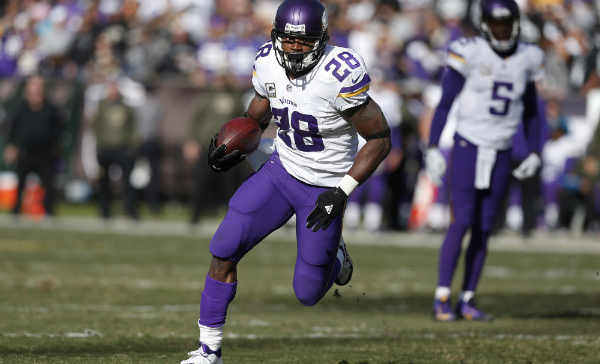 Peterson Helps Vikings Run Past Raiders 30-14