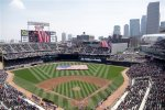 Members of the Armed Forces hold a large flag at Target field where the Minnesota Twins hosted Armed Forces Appreciation Day prior to the baseball game between the Twins and the Kansas City Royals. (AP Photo/Jim Mone)