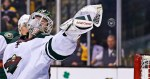 Minnesota Wild goalie Devan Dubnyk reaches back to make a save during the second period of an NHL hockey game against the Boston Bruins in Boston Thursday, Nov. 19, 2015. (AP Photo/Charles Krupa)