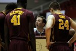 Minnesota university basketball coach Richard Pitino, center, talk to his players during a time out at the Puerto Rico Tip-Off college basketball tournament against Texas Tech in San Juan, Friday, Nov. 20, 2015. (AP Photo/Ricardo Arduengo)