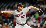 Minnesota Twins pitcher Mike Pelfrey delivers in the first inning of the second baseball game of a doubleheader against the Cleveland Indians, Wednesday, Sept. 30, 2015, in Cleveland. (AP Photo/Tony Dejak)