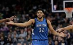 Minnesota Timberwolves center Karl-Anthony Towns (32) during the second half of an NBA basketball game against the San Antonio Spurs, Monday, Dec. 28, 2015, in San Antonio.  San Antonio won 101-95. (AP Photo/Eric Gay)