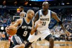 San Antonio Spurs' Tony Parker, left, of France, drives around Minnesota Timberwolves' Kevin Garnett, right,  in the first quarter of an NBA basketball game, Wednesday, Dec. 23, 2015, in Minneapolis. (AP Photo/Jim Mone)