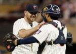 Minnesota Twins pitcher Kevin Jepsen, left, and catcher Kurt Suzuki celebrate after the Twins' 3-0 win over the Chicago White Sox in a baseball game, Wednesday, Sept. 2, 2015, in Minneapolis. Jepsen picked up the save. (AP Photo/Jim Mone)