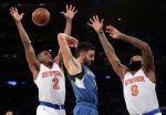 Minnesota Timberwolves guard Ricky Rubio (9) passes off the ball against New York Knicks guard Langston Galloway (2) and forward Kyle O'Quinn (9) during the first quarter of an NBA basketball game, Wednesday, Dec. 16, 2015, in New York. (AP Photo/Julie Jacobson)