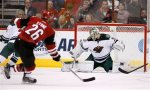Minnesota Wild's Darcy Kuemper, right, makes a save on a shot by Arizona Coyotes' Michael Stone (26) during the first period of an NHL hockey game Friday, Dec. 11, 2015 in Glendale, Ariz. (AP Photo/Ross D. Franklin)