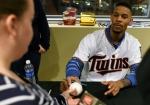 Minnesota Twins' Byron Buxton, right, signs an autograph during the baseball team's TwinsFest on Friday, Jan. 23, 2015, in Minneapolis. (AP Photo/Hannah Foslien)