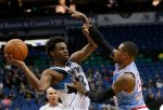 Minnesota Timberwolves guard Andrew Wiggins, left, looks to pass to a teammate under pressure from Sacramento Kings guard Ben McLemore, right, during the first half of an NBA basketball game in Minneapolis, Friday, Dec. 18, 2015.  (AP Photo/Ann Heisenfelt)