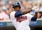 Minnesota Twins' Miguel Sano warms up in the batters box before making his home debut in a baseball game against the Baltimore Orioles, Monday, July 6, 2015, in Minneapolis. (AP Photo/Jim Mone)
