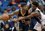Indiana Pacers forward Paul George (13) drives against Minnesota Timberwolves guard Andrew Wiggins during the second half of an NBA basketball game in Minneapolis, Saturday, Dec. 26, 2015. The Pacers won 102-88. (AP Photo/Ann Heisenfelt)