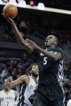 Minnesota Timberwolves' Gorgui Dieng (5) goes to the basket past Detroit Pistons' Andre Drummond (0) during the second half of an NBA basketball game Thursday, Dec. 31, 2015, in Auburn Hills, Mich. The Pistons defeated the Timberwolves 115-90. (AP Photo/Duane Burleson)