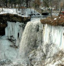 Minnehaha Falls, frozen over in winter.