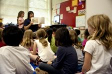 typical-classroom-scene-where-an-audience-of-school-children-were-seated-on-the-floor-725x482