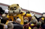 Minnesota mascot Goldie Gopher performs during an WCHA college hockey playoff game between Minnesota and Alaska, Friday, March 11, 2011, in Minneapolis. (AP Photo/Paul Battaglia)