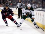 Minnesota Wild's Zach Parise, right, works for the puck against Columbus Blue Jackets' Gregory Campbell during the first period of an NHL hockey game in Columbus, Ohio, Tuesday, Jan.5, 2016. (AP Photo/Paul Vernon)