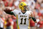 North Dakota State quarterback Carson Wentz throws a pass during the second half of an NCAA college football game against Iowa State, Saturday, Aug. 30, 2014, in Ames, Iowa. North Dakota State won 34-14. (AP Photo/Charlie Neibergall)