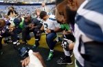 Seattle Seahawks quarterback Russell Wilson (3) prays after an NFL football game against the Baltimore Ravens, Sunday, Dec. 13, 2015, in Baltimore. The Seahawks won 35-6. (AP Photo/Patrick Semansky)