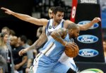 Denver Nuggets guard Jameer Nelson, right, drives around Minnesota Timberwolves' Ricky Rubio, of Spain, in the first quarter of an NBA basketball game, Wednesday, Jan. 6, 2016, in Minneapolis. (AP Photo/Jim Mone)