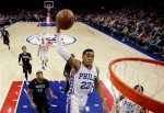 Philadelphia 76ers' Richaun Holmes (22) goes up for a dunk during the first half of an NBA basketball game against the Minnesota Timberwolves, Monday, Jan. 4, 2016, in Philadelphia. (AP Photo/Matt Slocum)