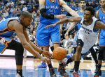 Oklahoma City Thunder's Kevin Durant, left, and Minnesota Timberwolves' Andrew Wiggins chase the loose ball in the first quarter of an NBA basketball game, Wednesday, Jan. 27, 2016, in Minneapolis. (AP Photo/Jim Mone)