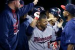 Minnesota Twins' Eduardo Escobar smiles in the dugout after his two-run home run during the ninth inning of a baseball game against the Detroit Tigers, Saturday, Sept. 26, 2015 in Detroit. (AP Photo/Carlos Osorio)