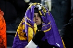 A Minnesota Vikings fan is bundled up against the cold during the second half of an NFL football game against the New York Giants, Sunday, Dec. 27, 2015, in Minneapolis. (AP Photo/Ann Heisenfelt)
