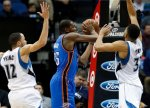 Oklahoma City Thunder's Kevin Durant, center, looks to bass as Minnesota Timberwolves' Tayshaun Prince, left, and Karl-Anthony Towns defend in the first quarter of an NBA basketball game, Tuesday, Jan. 12, 2016, in Minneapolis. (AP Photo/Jim Mone)