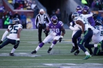 Minnesota Vikings running back Adrian Peterson (28) runs the ball during the first half of an NFL wild-card football game against the Seattle Seahawks, Sunday, Jan. 10, 2016, in Minneapolis. (AP Photo/Jim Mone)