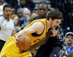 Cleveland Cavaliers' Kevin Love, foreground, drives and is fouled by Minnesota Timberwolves' Gorgui Dieng, of Senegal, in the first quarter of an NBA basketball game, Friday, Jan. 8, 2016, in Minneapolis. (AP Photo/Jim Mone)