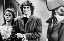"""Actress Melissa Sue Anderson, left, who plays Mary for the television series """" Little House on the Prairie"""" is escorted by actor Michael Landon, who plays her father, are shown during the taping of Mary's wedding scene in Los Angeles, Calif. Sept. 11, 1978. (AP Photo/Huynh)"""