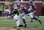 Seattle Seahawks tight end Luke Willson (82) catches a pass as Minnesota Vikings free safety Harrison Smith (22) defends in the first half of an NFL football game Sunday, Dec. 6, 2015 in Minneapolis. (AP Photo/Jim Mone)