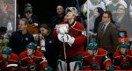 Minnesota Wild goalie Devan Dubnyk checks the scoreboard from the bench during the third period of an NHL hockey game against the Buffalo Sabres in St. Paul, Minn., Tuesday, Jan. 12, 2016. The Sabres won 3-2. (AP Photo/Ann Heisenfelt)