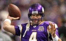 Minnesota Vikings quarterback Brett Favre (4) attempts throwing on the sidelines after an injury in the first quarter of an NFL football game against the Buffalo Bills in Minneapolis, Sunday, Dec. 5, 2010. (AP Photo/Andy King)