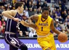 Minnesota guard Dupree McBrayer, right, drives against Northwestern guard Bryant McIntosh during the first half of an NCAA college basketball game on Thursday, Feb. 4, 2016, in Evanston, Ill. (AP Photo/Nam Y. Huh)