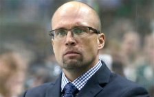 Minnesota Wild head coach Mike Yeo watches from the bench during the first period of an NHL hockey game against the Dallas Stars Saturday, Jan. 9, 2016, in Dallas. (AP Photo/LM Otero)