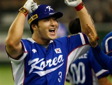 FILE - In this Saturday, Nov. 21, 2015 file photo, South Korea's Park Byung-ho celebrates at the bench after hitting a three-run home run against Team USA in the fourth inning of their final game at the Premier12 world baseball tournament at Tokyo Dome in Tokyo. South Korean first baseman Byung Ho Park has agreed to a $12 million, four-year contract with the Minnesota Twins, Tuesday, Dec. 1, 2015.  (AP Photo/Toru Takahashi, File)