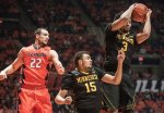 Minnesota forward Jordan Murphy (3) grabs a rebound away from Minnesota guard Stephon Sharp (15) and Illinois center Maverick Morgan (22) in the first half of an NCAA college basketball game at the State Farm Center in Champaign, Ill., on Sunday, Feb. 28, 2016. (AP Photo/Rick Danzl)