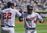 Minnesota Twins' Torii Hunter (48) high-fives designated hitter Miguel Sano (22) after hitting  a three-run home run in the first inning of a baseball game against the Chicago White Sox, Sunday, Sept. 13, 2015, in Chicago. (AP Photo/Matt Marton)