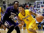 Minnesota guard Nate Mason, right, drives against Northwestern guard/forward Scottie Lindsey during the first half of an NCAA college basketball game on Thursday, Feb. 4, 2016, in Evanston, Ill. (AP Photo/Nam Y. Huh)