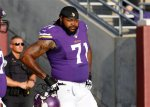 Minnesota Vikings tackle Phil Loadholt (71) takes the field before an NFL football game against the Oakland Raiders in Minneapolis Friday, Aug. 8, 2014. (AP Photo/Ann Heisenfelt)