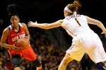 Ohio State guard Kelsey Mitchell (3) protects the ball against Minnesota guard Rachel Banham (1) in the first half of an NCAA college basketball game Wednesday, Feb. 24, 2016 in Minneapolis. (AP Photo/Stacy Bengs)