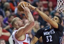 Portland Trail Blazers center Mason Plumlee, left, has his shot blocked by Minnesota Timberwolves center Karl-Anthony Towns, right, during the second half of an NBA basketball game in Portland, Ore., Sunday, Jan. 31, 2016. (AP Photo/Craig Mitchelldyer)