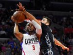 Los Angeles Clippers guard Chris Paul, left, shoots as Minnesota Timberwolves guard Ricky Rubio defends during the first half of an NBA basketball game Wednesday, Feb. 3, 2016, in Los Angeles. (AP Photo/Mark J. Terrill)
