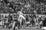 Minnesota Viking quarterback Joe Kapp is lifted high into the air by Green Bay Packers' Lee Roy Caffey (60) after pass by Kapp in first half of National Football League game in Twin Cities on Sunday, Dec. 3, 1967 in Minneapolis.  Pass went incomplete. (AP Photo)