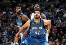 Minnesota Timberwolves center Karl-Anthony Towns (32), front, boxes out Denver Nuggets forward Kenneth Faried (35), center, as Minnesota Timberwolves guard Andrew Wiggins (22) looks on in the second half of an NBA basketball game Friday, Dec.11, 2015, in Denver. Denver won 111-108 in overtime. (AP Photo/David Zalubowski)