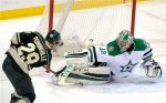 Dallas Stars' goalie Kari Lehtonen, right, of Finland, makes the pad save on Minnesota Wild's Jason Pominville (29) in the first period of an NHL hockey game, Tuesday, Feb. 9, 2016, in St. Paul, Minn. (AP Photo/Tom Olmscheid)