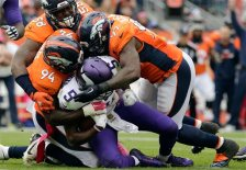 Minnesota Vikings quarterback Teddy Bridgewater (5) is sacked by Denver Broncos outside linebacker Von Miller (58) outside linebacker DeMarcus Ware (94) and defensive end Malik Jackson (97) during the first half of an NFL football game Sunday, Oct. 4, 2015, in Denver. (AP Photo/Joe Mahoney)