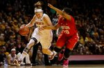 FILE - In this Feb. 24, 2016, file photo, Minnesota guard Rachel Banham (1) drives the ball past Ohio State guard Asia Doss (20) in the second half of an NCAA college basketball game, in Minneapolis. Banham has earned a spot on The Associated Press All-America team it was announced Monday, March 28, 2016. (AP Photo/Stacy Bengs, File)