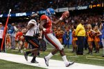 Mississippi wide receiver Laquon Treadwell (1) scores a touchdown as Oklahoma State cornerback Darius Curry covers in the second half of the Sugar Bowl college football game in New Orleans, Friday, Jan. 1, 2016. (AP Photo/Jonathan Bachman)
